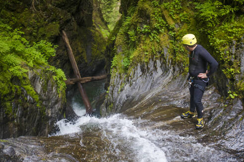 High angle of a man looking over the edge of a waterfall - CAVF65775