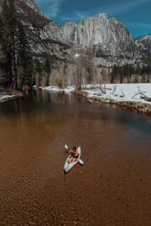 Man kayaking in lake, Yosemite Village, California, United States - ISF22628