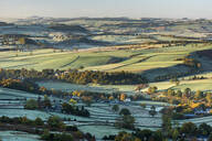 View from Curbar Edge at sunrise in autumn, looking south towards Baslow and Chatsworth, Peak District National Park, Derbyshire, England, United Kingdom, Europe - RHPLF12568