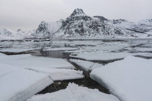 Cracked ice and snow covered mountains, Lofoten Islands, Nordland, Arctic, Norway, Europe - RHPLF12607