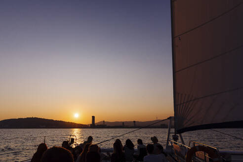Spain, Catalonia, Panoramic views of the city of Barcelona from a boat at sunset - MOSF00115