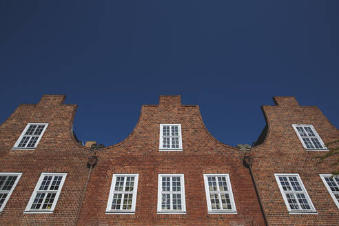 Germany, Brandenburg, Potsdam, Low angle view of brick houses of Dutch Quarter neighborhood - ASCF01049