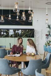 Friends having coffee in a cafe - MOMF00779