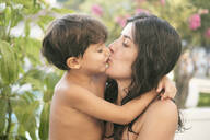 Little son kissing his mother outdoors - JASF02075