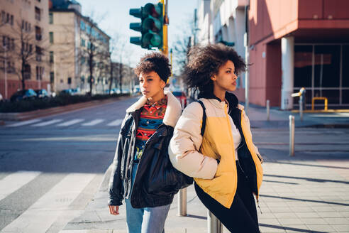 Two cool young women standing on city street - CUF52808