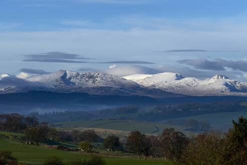Scenic landscape with distant snow capped mountains, Llanberis, Gwynedd, Wales - CUF52877