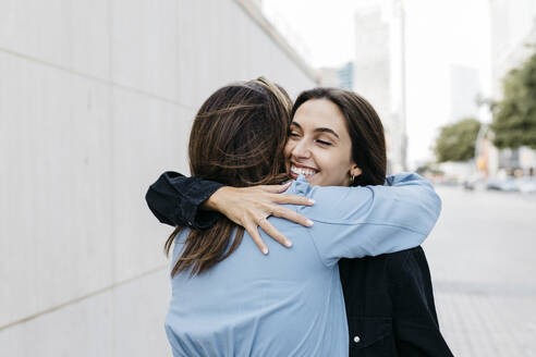 Two women hugging each other - JRFF03796