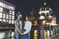 Smiling couple in love in the city with Berlin Cathedral in the background, Berlin, Germany - WPEF02151