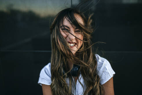 Laughing woman with hairs on her face, black background - KIJF02696