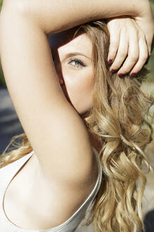 Portrait of young blond woman looking at camera - JPTF00354