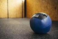 Blue medicine ball in a corner of a gym - MTBF00074