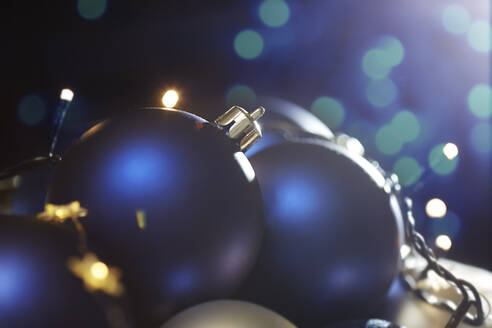 Close-up of Christmas baubles with fairy lights - CAVF66718