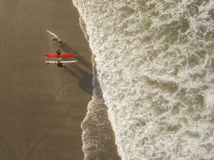 Aerial view of surfers at the beach - CAVF66859