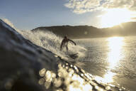 Surfer on a wave at sunset time - CAVF67335