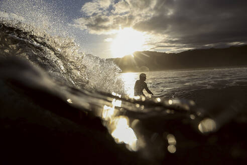 Surfer on a wave at sunset time - CAVF67338