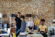 Portrait of confident young people at table in a loft - SODF00127