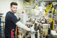 Portrait of confident man working in a modern factory - WESTF24304