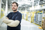 Portrait of confident worker in a modern factory - WESTF24316