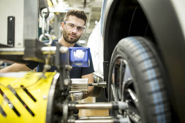 Portrait of confident man working in modern car factory - WESTF24379