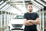 Portrait of confident worker in modern car factory - WESTF24400