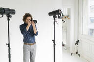 Photographer taking pictures in his studio - GIOF07547