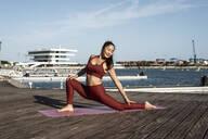Asian woman practicing yoga - RCPF00080