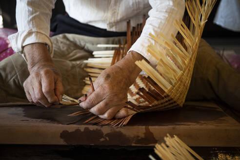 Japan, Takayama, Craftsman making baskets in workshop - ABZF02743