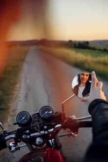 Mirror image of young biker - JPIF00243