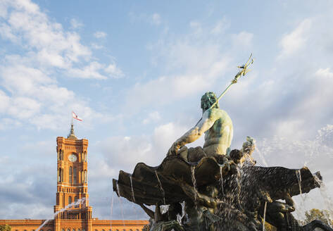 Germany, Berlin, Neptune Fountain against Rotes Rathaus building - GWF06212