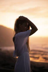 Young woman at the beach during sunrise - MTBF00128