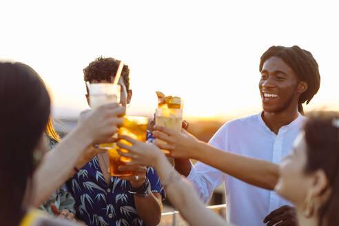 Happy multi-ethnic friends toasting drinks - SODF00182