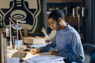Young man working in architect's office - SODF00206