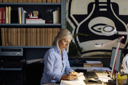 Mature woman working in architct's office - SODF00209