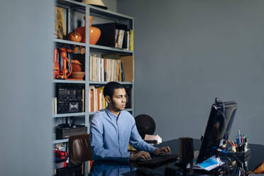 Young designer working in his office - SODF00236