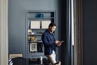Matuer man using digital tablet in his design office - SODF00260