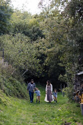 Family with two kids walking in the countryside - SODF00317