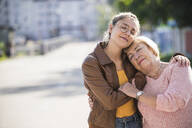 Granddaughter embracing her grandmother - UUF19515