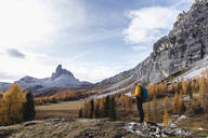 Man hiking at Dolomites Alps, Veneto, Italy - MCVF00079