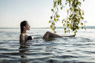 Young woman bathing in Lake Starnberg, Germany - WFF00157