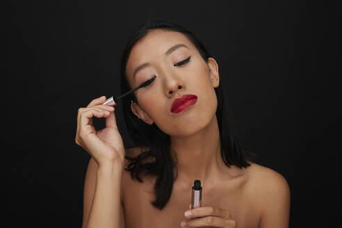Portrait of young female Chinese woman, eyelashes, mascara - PGCF00068
