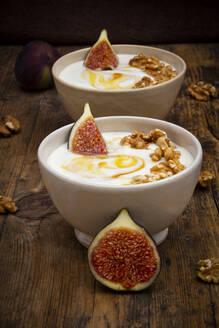 Bowls of Greek yogurt with honey, walnuts and fig - LVF08418