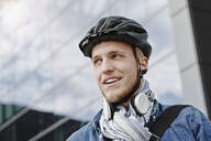 Portrait of student with cycling helmet  and headphones - RORF01962