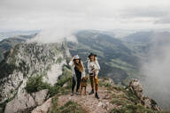 Two young women with dogs on viewpoint, Grosser Mythen, Switzerland - LHPF01142
