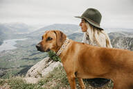Woman with dog on viewpoint, Grosser Mythen, Switzerland - LHPF01148