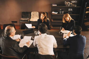 High angle view of financial advisors brainstorming in board room at office - MASF14489