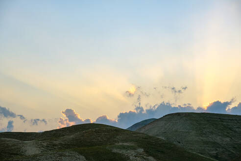 Sunset behind hills in the Judean Desert, Jericho, West Bank, Palestine - CAVF69140