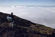 Hiker on viewpoint looking at distance, Ponta do Pico, Azores, Portugal - MCF00320