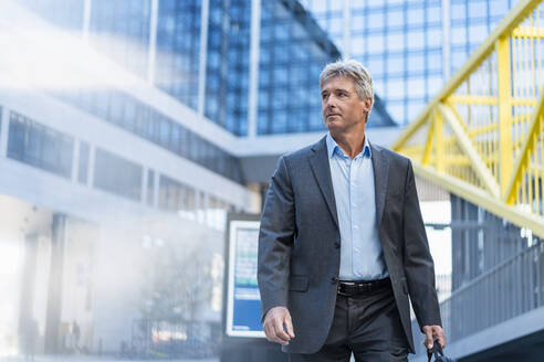 Mature businessman on the go in the city - DIGF08900