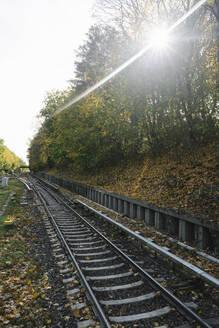 Railway tracks of a metro line in backlight, Berlin, Germany - AHSF01239