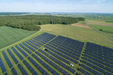 Germany, Bavaria, Aerial view of countryside solar farm in spring - RUEF02380